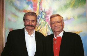 "WEST HOLLYWOOD, CA - OCTOBER 25: Artist LeRoy Neiman and publisher Hugh Hefner pose in front of Neiman's Statue of Liberty painting to celebrate his new book, ""LeRoy Neiman: Five Decades"", in the Timothy Yarger Fine Art Gallery October 25, 2003 in Beverly Hills, California. (Photo by David Klein/Getty Images)"